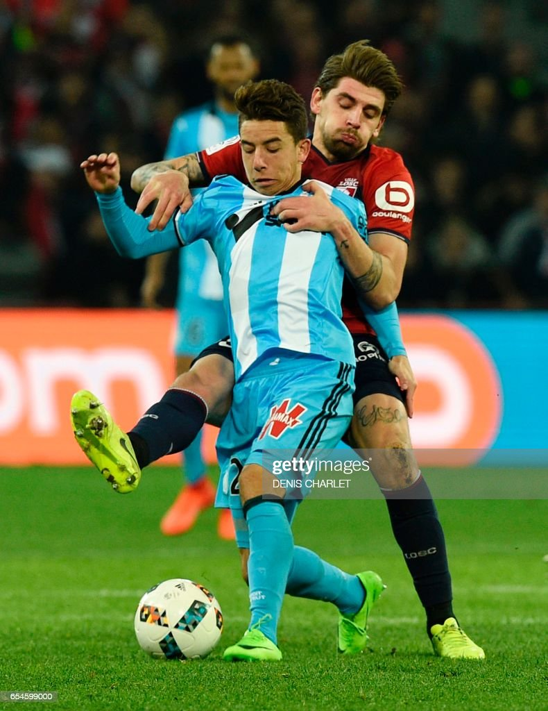 Lille's midfielder Xeka (R) vies with Olympique de Marseille's French midfielder Maxime Lopez during the French L1 football match between Lille OSC (LOSC) and Marseille on March 17, 2017 at the Pierre-Mauroy Stadium in Villeneuve d'Ascq, near Lille, northern France. /