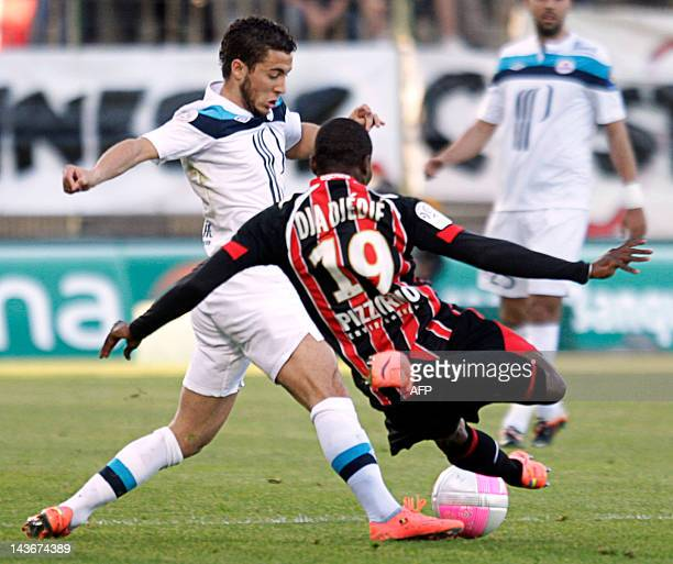 Lille's mildfielder Eden Hazard vies with Nice's forward Franck Dja Dje Dje during their French L1 football match Nice vs Lille on May 2 2012 at the...