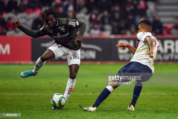 Lille's Mozambican defender Reinildo Mandava vies with Dijon's midfielder Mama Balde during the French L1 football match between Lille and Dijon at...