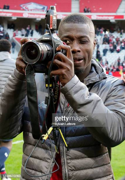 Lille's Nicolas Pepe takes pictures of his team mates who celebrates at the end of the Ligue 1 match between Lille and Bordeaux at Stade Pierre...