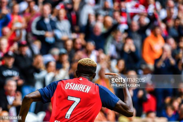 Lille's Nigerian forward Victor Osimhen celebrates after scoring a goal during the French L1 football match between Lille and FC Nantes at the Pierre...
