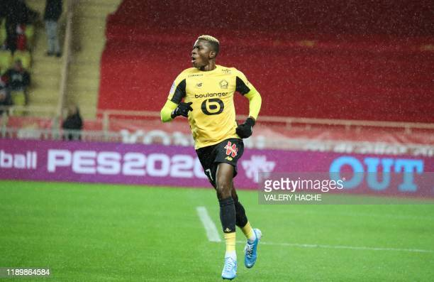 Lille's Nigerian forward Victor Osimhen celebrates after scoring a goal during the French L1 football match between AS Monaco and Lille OSC at the...