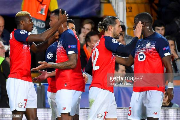 Lille's Nigerian forward Victor Osimhen celebrates with teammates after scoring a goal during the UEFA Champions League group H football match...