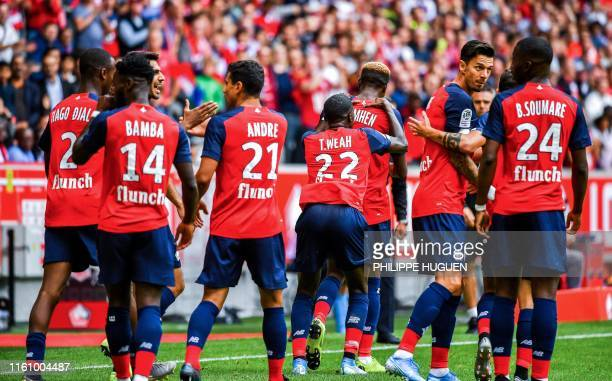 Lille's Nigerian forward Victor Osimhen is congratulated by his teammates after scoring a goal during the French L1 football match between Lille and...