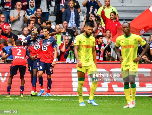 Lille's Nigerian forward Victor Osimhen is congratulated by his teammates after scoring a second goal during the French L1 football match between...