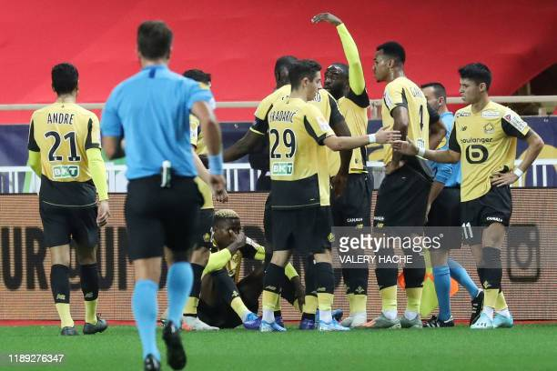 """Lille's Nigerian forward Victor Osimhen reacts after scoring a goal during the French League Cup football match between Monaco vs Lille at the """"Louis..."""