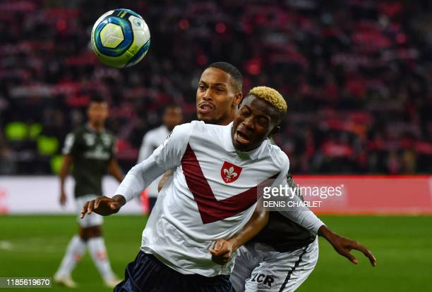 Lille's Nigerian forward Victor Osimhen vies for the ball with Dijon's French defender Mickael Alphonse during the French L1 football match between...