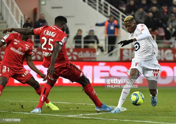 Lille's Nigerian forward Victor Osimhen vies with Dijon's Gabonese defender Bruno Ecuele Manga during the French L1 football match between Dijon...