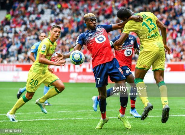Lille's Nigerian forward Victor Osimhen vies with Nantes' Malian defender Molla Wague during the French L1 football match between Lille and FC Nantes...