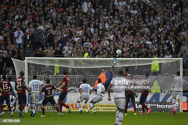 Lille's Nigerian goalkeeper Vincent Enyeama jumps to stop the ball during the French L1 football match between Lyon and Lille at the Gerland stadium...