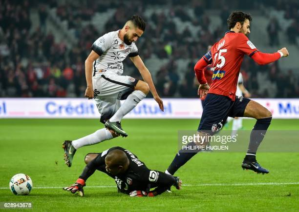 Lille's Nigerian goalkeeper Vincent Enyeama vies with Montpellier's French midfielder Ryad Boudebouz during the French L1 football match Lille vs...