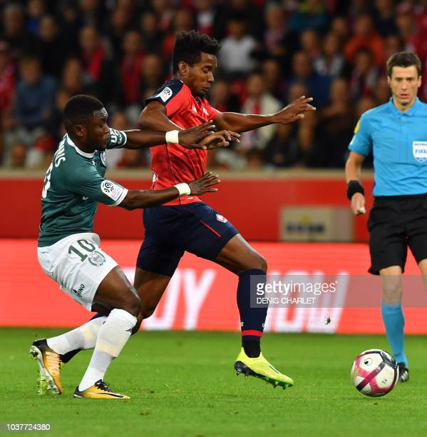 Lille's Paraguaian defender Junior Alonso vies with Nantes' Ghanaian forward Majeed Waris during the French L1 football match between Lille and...