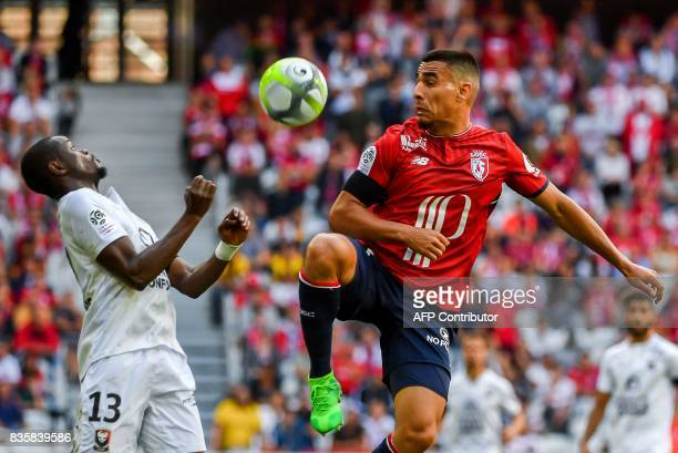 Lille's Paraguay defender Junior Alonso fights for the ball with Caen's French forward Christian Kouako Yao during the French L1 football match Lille...