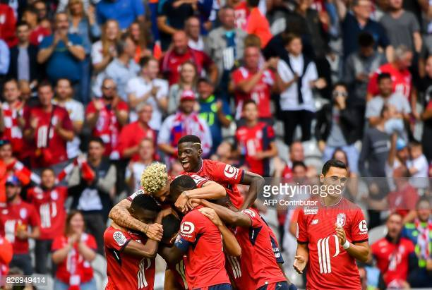 Lille's Paraguay defender Junior Alonso is congratuled by teammates after scoring a goal during the French Ligue 1 football match between Lille and...