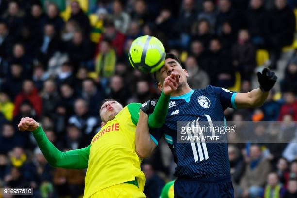 Lille's Paraguay defender Junior Alonso jumps for the ball with Nantes' Argentinian forward Emiliano Sala during the French L1 football match between...