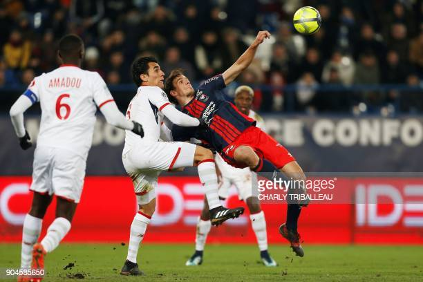 Lille's Paraguay defender Junior Alonso vies for the ball with Caen's Croatian forward Ivan Santini during the French L1 football match between Caen...