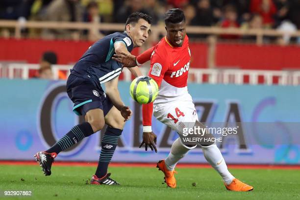 Lille's Paraguay defender Junior Alonso vies with Monaco's Spanish forward Keita Balde during the French L1 football match Monaco vs Lille on March...