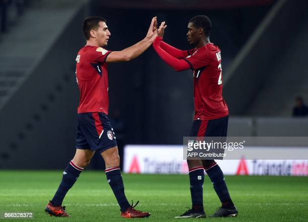 Lille's Paraguayan defender Junior Alonso and Lille's Malian midfielder Yves Bissouma celebrate after Alonso scored during the French League Cup...