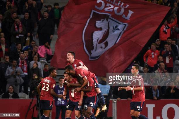Lille's Paraguayan defender Junior Alonso celebrates with teammates after scoring during the French League Cup round of 16 football match between...