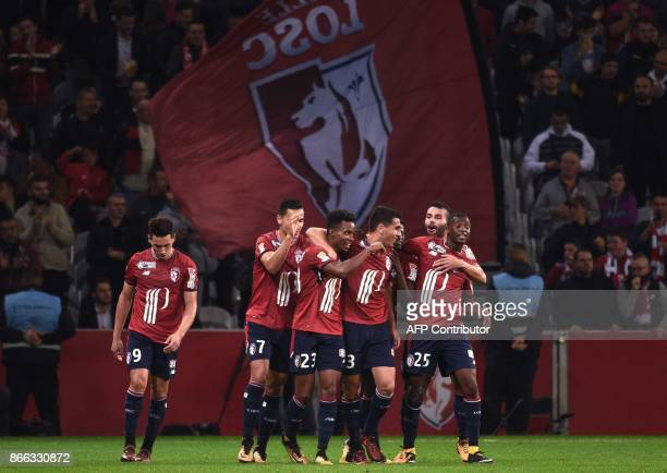 Lille's Paraguayan defender Junior Alonso celebrates with teammates Lille's Argentinian forward Ezequiel Ponce Lille's DutchMorrocan forward Anwar...