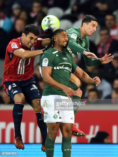 Lille's Paraguayan defender Junior Alonso SaintEtienne' Swiss defencer Saidy Janko and SaintEtienne's Norwegian midfielder Ole Selnaes go for a...