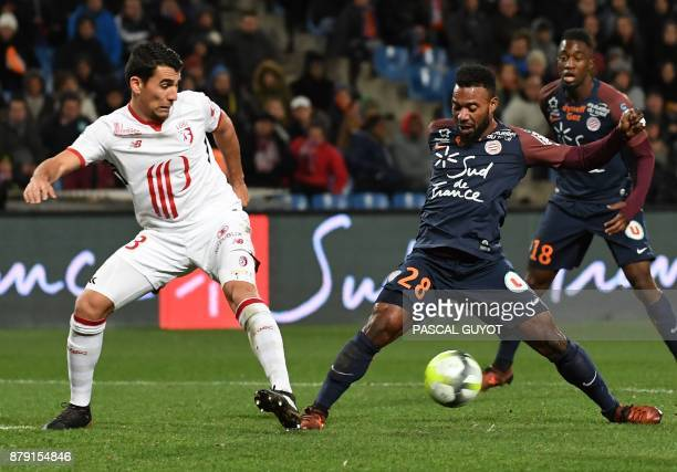 Lille's Paraguayan defender Junior Alonso vies with Montpellier's French midfielder Stephane Sessegnon during the French L1 football match between...