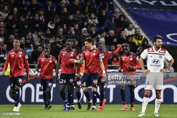 Lille's players celebrate after Lille's French midfielder Boubakary Soumare scored a goal during the French L1 football match between Olympique...