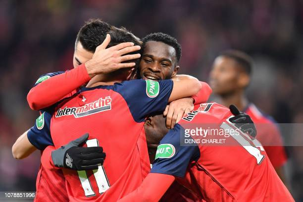 Lille's players celebrate after scoring during the French Cup last-64 football match between Lille LOSC and Football Club Sochaux-Montbeliard at the...
