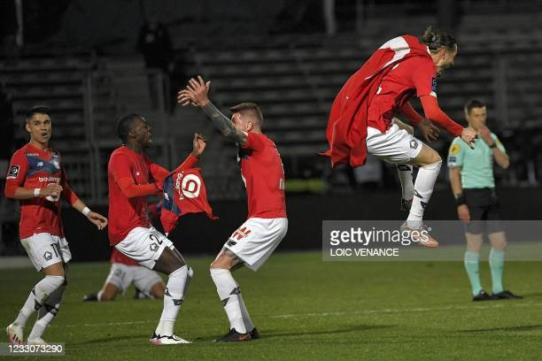 Lille's players celebrate after winning the French L1 football match between Angers SCO and Lille OSC at The Raymond-Kopa Stadium in Angers,...