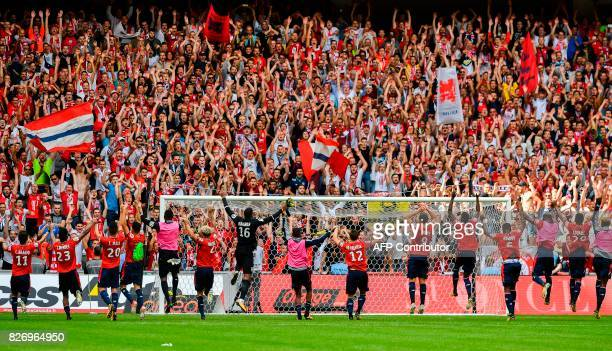 TOPSHOT Lille's players celebrate after winning the French Ligue 1 football match between Lille and Nantes on August 6 2017 at Pierre Mauroy Stadium...
