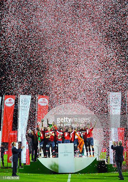 Lille's players celebrate their French Ligue 1 title with the trophy at the end of the French L1 football match Lille vs Rennes on May 29 2011 at...