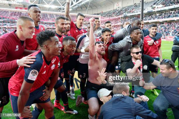 Lille's players celebrate with fans at the end of match Lille vs Bordeaux at Stade Pierre Mauroy on May 12, 2019 in Lille, France.