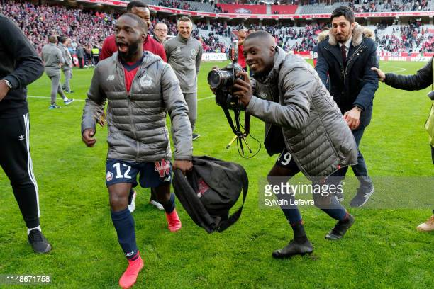 Lille's players Jonathan Ikone and Nicolas Pepe who takes pictures of team mates, celebrate at the end of match Lille vs Bordeaux at Stade Pierre...