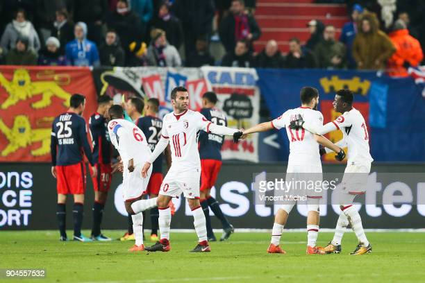 Lille's players jubilate after the first goal during the Ligue 1 match between Caen and Lille at Stade Michel D'Ornano on January 13 2018 in Caen...