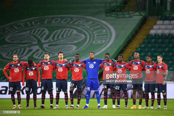 Lille's players observe a minute of silence as they pay their respects to the former Italian international Paolo Rossi ahead of the UEFA Europa...