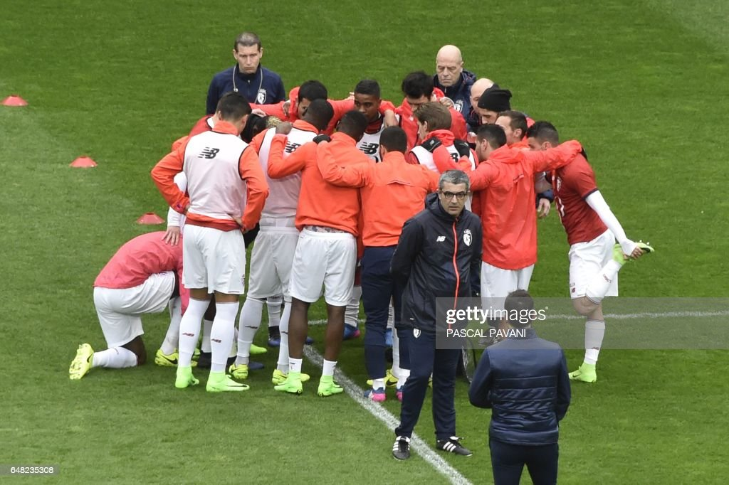 Lille's players warm up before the French L1 football match Toulouse against Lille on March 05, 2017 at the Municipal Stadium in Toulouse, southern France. /