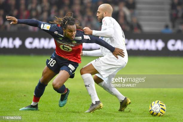 Lille's portugal midefielder Renato Sanches vies with Amiens' defender Haitam Aleesami during the French Ligue Cup quarterfinal football match...