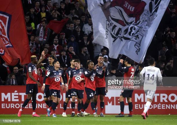 Lille's Portugese midefielder Renato Sanches celebrates with teammates after scoring a goal during the French L1 football match between Lille and...