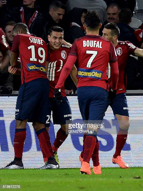 Lille's Portugese midfielder Rony Lopes celebrates with teammates after scoring a goal during the French L1 football match between Lille and Reims on...