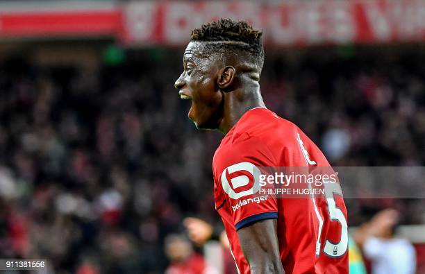 Lille's Portuguese defender Edgar Ie celebrates after scoring a goal during the French L1 football match between Lille and Strasbourg on Janaury 28...
