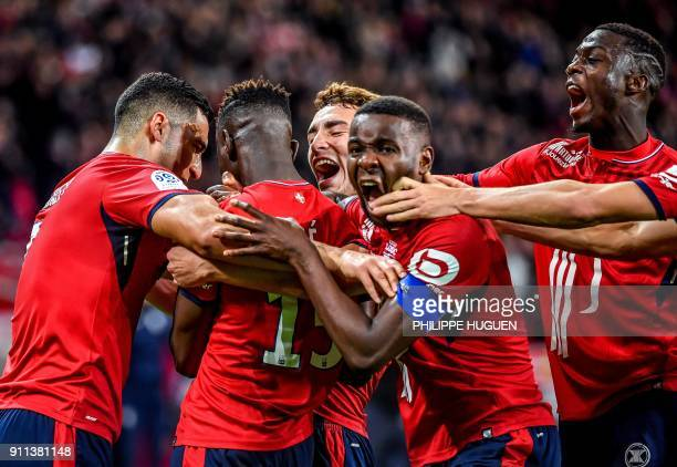 Lille's Portuguese defender Edgar Ie celebrates with teammates after scoring a goal during the French L1 football match between Lille and Strasbourg...