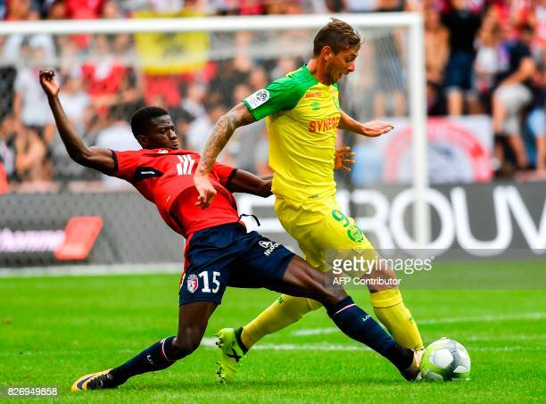 Lille's Portuguese defender Edgar Ie vies with Nantes' French forward Emiliano Sala during the French Ligue 1 football match between Lille and Nantes...