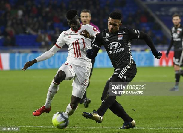 Lille's Portuguese defender Edgar Le vies with Lyon's Dutch forward Memphis Depay during the French L1 football match between Olympique Lyonnais and...