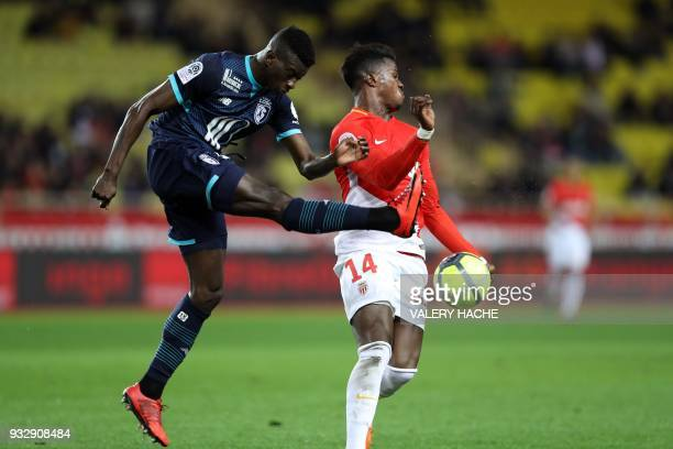Lille's Portuguese defender Edgar Le vies with Monaco's Spanish forward Keita Balde during the French L1 football match Monaco vs Lille on March 16...