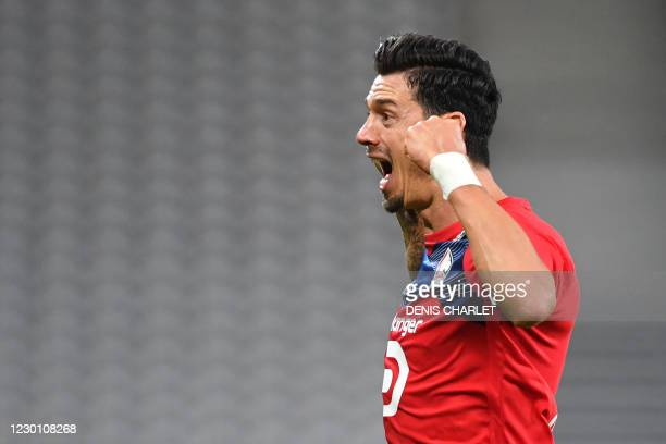 Lille's Portuguese defender Jose Fonte celebrates after scoring his team's second goal during the French L1 football match between Lille LOSC and FC...