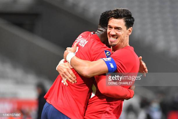 Lille's Portuguese defender Jose Fonte celebrates with a teammate after scoring his team's second goal during the French L1 football match between...