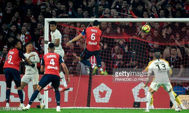Lille's Portuguese defender Jose Fonte scores a goal during the French L1 football match between Lille and Paris SaintGermain on April 14 at the...