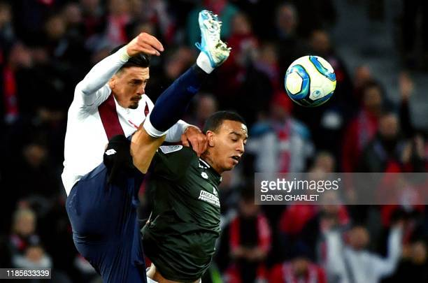 Lille's Portuguese defender Jose Fonte vies for the ball with Dijon's Venezuelan forward Jhonder Cadiz during the French L1 football match between...