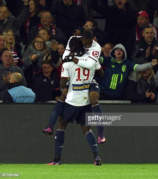 Lille's Portuguese forward Eder celebrates with teammates after scoring a goal during the French L1 football match between Lille OSC and Bastia at...