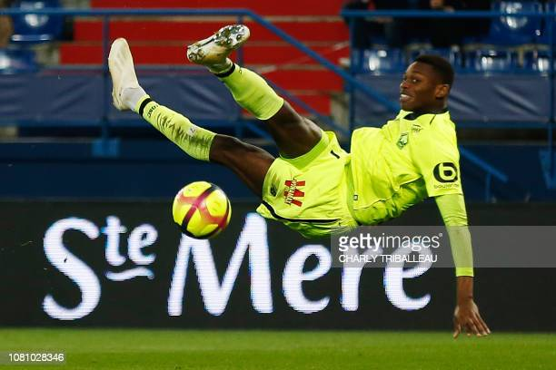 Lille's Portuguese forward Rafael Da Conceicao Leao jumps for the ball during the French L1 football match between Caen and Lille on January 11 at...